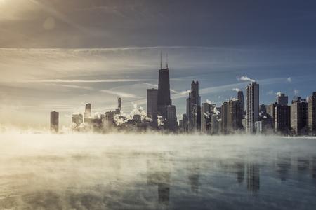 Chicago Downtown with winter fog on Lake Michigan. Arctic polar vortex. Sunbeam Reklamní fotografie