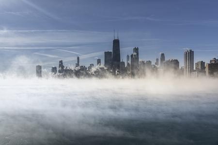 Downtown Chicago skyline during winter polar vortex. Fog drifts above Lake Michigan Reklamní fotografie
