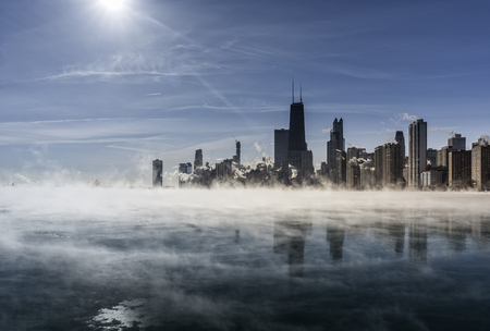 Chicago Downtown skyline during winter polar vortex .Fog drifts across Lake Michigan Reklamní fotografie
