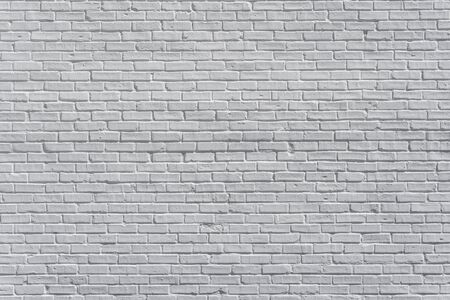 Brick painted white wall with delicate shadows, can be used for texture or background Foto de archivo