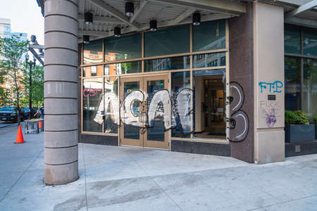 CHICAGO, ILLINOIS - MAY 31, 2019: Chase Bank branch front entrance with broken window and graffiti after demonstrations against police in Chicago.