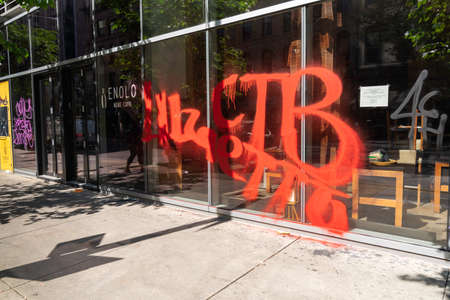 CHICAGO, ILLINOIS - MAY 31, 2019: Streets of Chicago with store fronts damaged and full of graffiti after demonstrations against police
