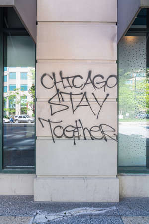 CHICAGO, ILLINOIS - MAY 31, 2019: Wall graffiti after Chicago's justice for George Floyd protests