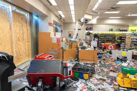 CHICAGO, ILLINOIS - MAY 31, 2019: CVS Pharmacy store interior destroyed by the protesters after nights of riots, looting and chaos in Downtown Chicago. Broken windows and debris on the floor Editorial