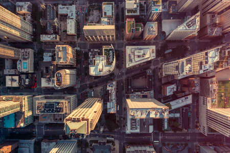 Overhead aerial view of Chicago Downtown skyscrapers. Urban grid with streets. Late afternoon light 版權商用圖片