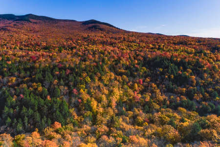 Aerial view of mountains with blue sky around Stowe in Vermont, fall scenery