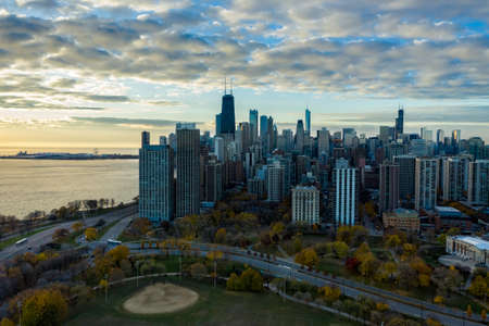 Aerial view of Chicago downtown skyline with park and the beach. Sunrise above big city