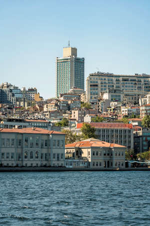 Old buildings and tall skyscraper along the shore of Bosphorus in Istanbul, Turkey. View from the water Foto de archivo