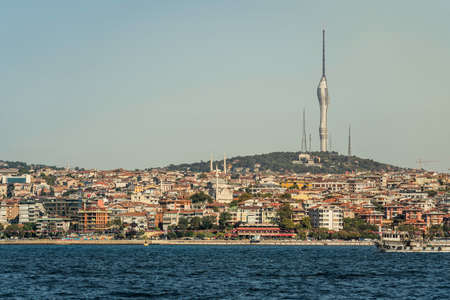 Panorama of Istanbul with tall Camlica television and radio tower on the hill of Uskudar, Turkey