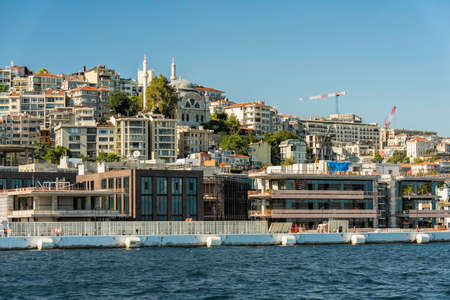 New construction buildings on the shore near Galata Tower, view from the water, Istanbul Foto de archivo