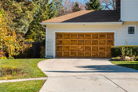 Traditional old wooden garage door with driveway