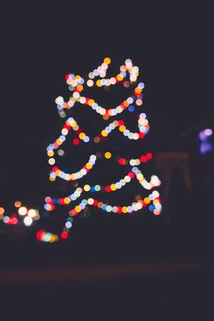 Seasonal Christmas Tree Decoration with Lights, outdoor blurred view. Xmas showcase Foto de archivo