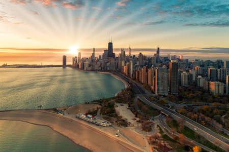 Aerial view of Chicago Downtown skyline at sunrise with sun rays