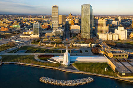 Aerial skyline panorama view of Downtown Milwaukee at sunrise. Tall downtown buildings by the lake