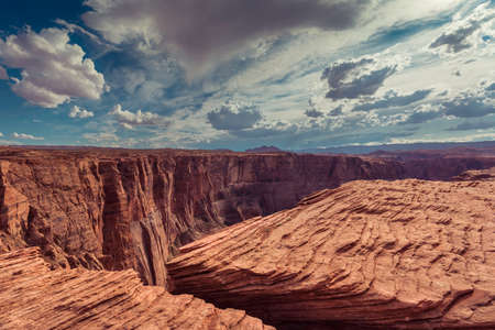Rock formations by the Colorado River in Arizona located in East Rim of Grand Canyon. Dramatic sky