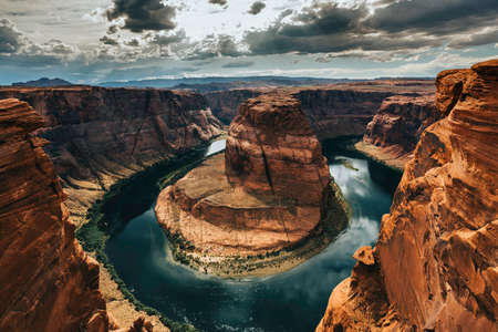 Horseshoe-shaped rock formation by the Colorado River in Arizona located in East Rim of Grand Canyon