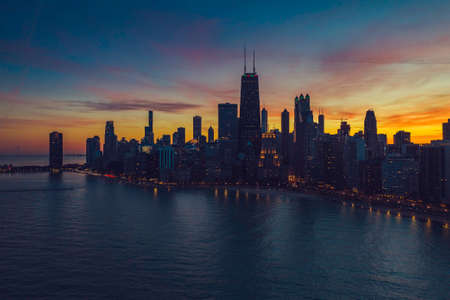 Beautiful sunset above Chicago lakefront skyscrapers, aerial view