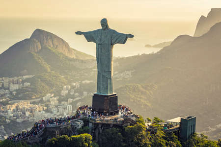 RIO DE JANEIRO, BRAZIL - FEBRUARY 2016:  Aerial view of Christ and Sugar Loaf Mountain, Rio De Janeiro, Brazil . People on the top of Corcovado Hill