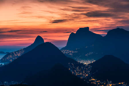 High angle panorama of Rio de Janeiro skyline sunset with dramatic sky, Brazil