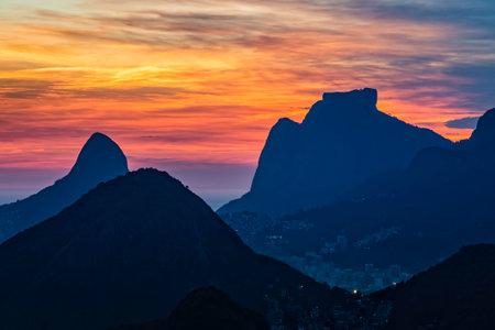 Aerial view of Rio de Janeiro with dramatic sky over the city and mountains 版權商用圖片