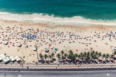 High angle view of Copacabana beach full of people relaxing on the sun, Rio de Janeiro