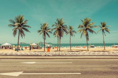 Sunny day with Palms on Ipanema Beach in Rio De Janeiro, Brazil