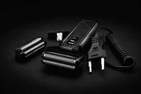 Rechargeable electric shaver for men, black background