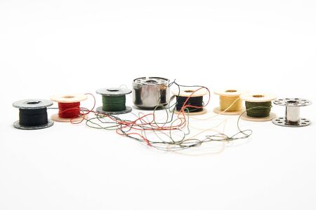 Spools of thread for a sewing machine on a white background