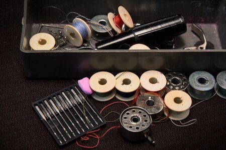 Box with spools of thread with needles for a sewing machine 写真素材