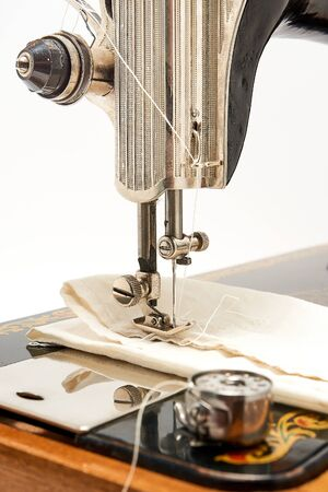 Sewing machine and parts on a white background