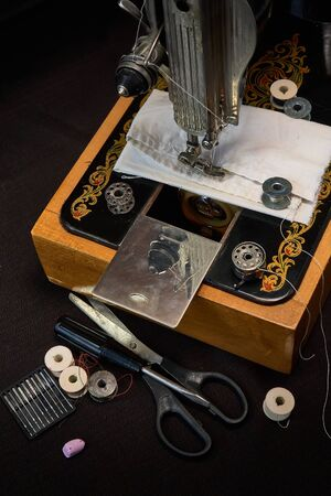 Sewing machine and parts on a dark background