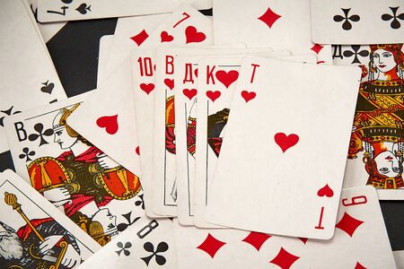 Playing cards on the background of scattered cards