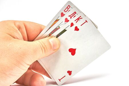 Playing cards in hand isolated on white background 写真素材