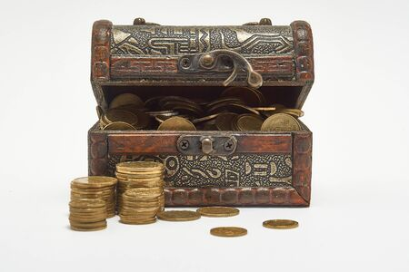 Chest with coins on a white background