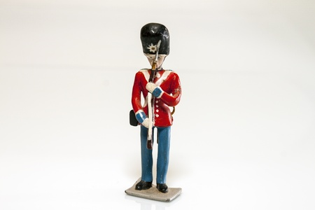 Tin Soldier of the royal guard on white background photo