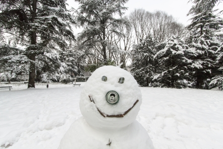 particular of a snowman made by children after a snowfall Stock Photo
