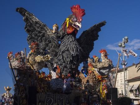 VIAREGGIO, ITALY - FEBRUARY 2:   allegorical float on the breeding of chickens at Viareggio Carnival held February 2, 2013