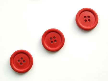 fancywork: three red buttons on white background