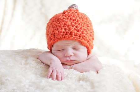 sweet sleeping baby with pumpkin hat Stock Photo