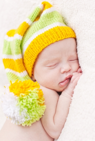 Close-up sleeping newbornon a white background with bright hat Stock Photo - 21379261