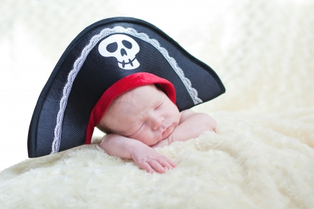 sleeping newborn baby in a pirate hat photo