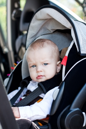Cute little boy in car seat photo