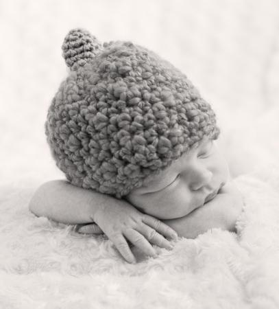 sweet newborn baby sleeping with  hat ( black and white ) photo