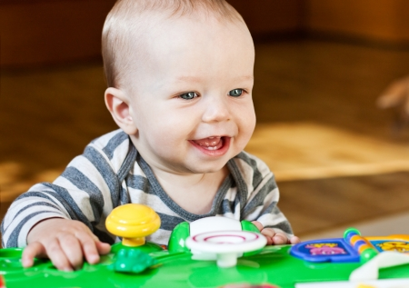 groping: cute baby boy playing at home and looking at the camera Stock Photo