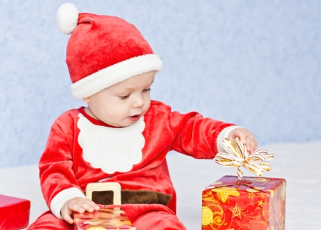 cute baby boy santa helper photo