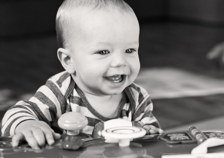 cute babies: cute baby boy playing at home  (black and white)