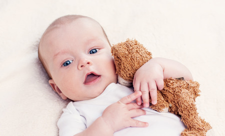 baby with a favorite toy supine