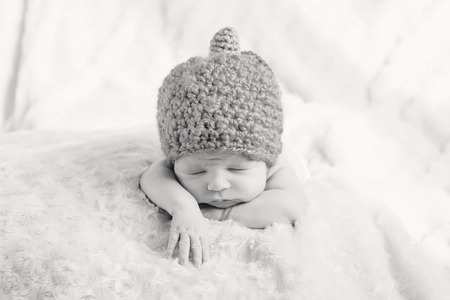 sweet sleeping baby with hat  (black and white) photo