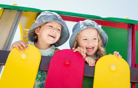 babies laughing: laughing toddler girls on the playground