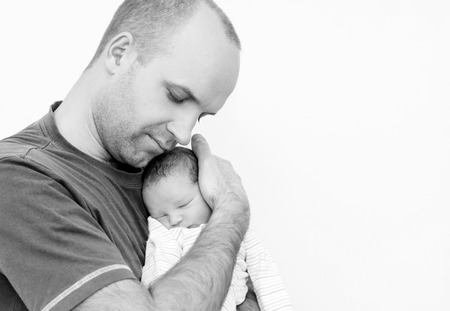 happy father with newborn on a white background ( black and white ) photo